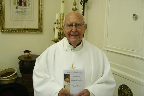 Father Brennan with the Mass Brochure