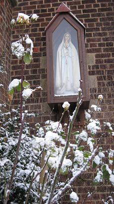 Statue of Our Lady in the snow