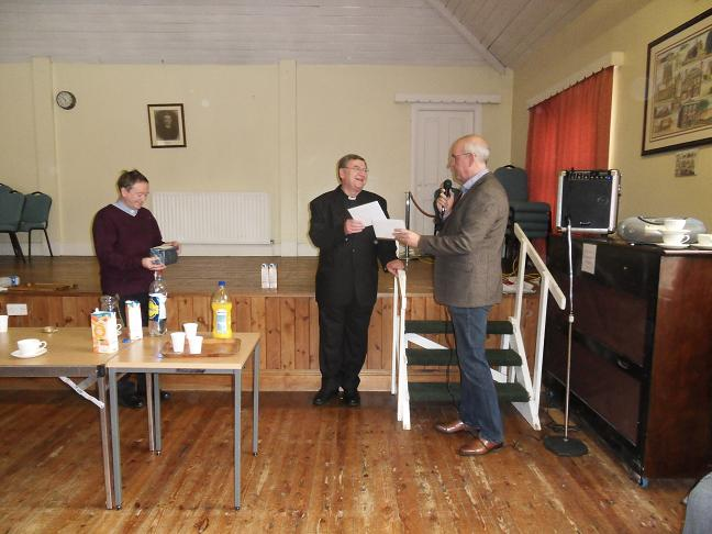 Presentation of a cheque to Father James