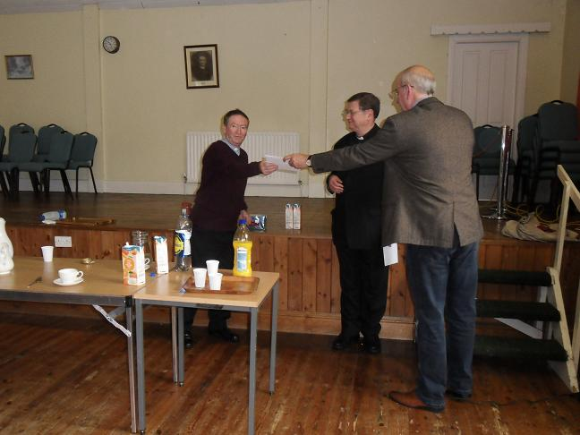 Presentation of a cheque to Deacon Paul